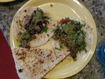 Carne asada and spicy pork tacos and a chorizo quesadilla from Taco Loco
