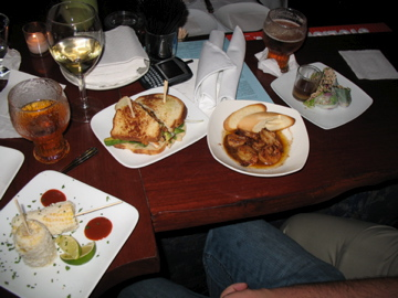 Corn, fish club, garlic shrimp, and duck spring rolls at Molly Fontaine's